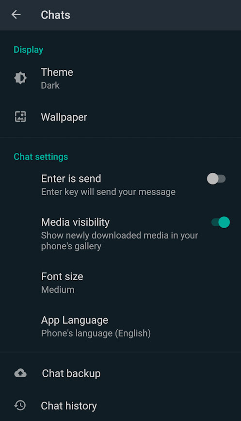 Go to Settings -> Chats -> Theme to enable the Dark mode in WhatsApp